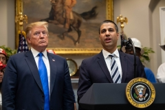U.S. President Donald Trump listens to Federal Communications Commission (FCC) chairman Ajit Pai speak during an announcement about 5G network deployment. (Photo credit: NICHOLAS KAMM/AFP via Getty Images)