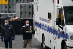 Members of the NYC Medical Examiners Office at the site as workers build a makeshift morgue outside of Bellevue Hospital to handle an expected surge in Coronavirus victims. (Photo credit: BRYAN R. SMITH/AFP via Getty Images)
