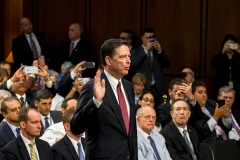Former FBI Director James Comey is sworn in at a hearing of the Senate intelligence committee on June 8, 2017. (Photo by Mark Reinstein/Corbis via Getty Images)