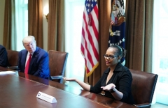 President Donald Trump and members of the Coronavirus Task Force listen to State Rep. Karen Whitsett (D-Mich.), who recovered from the novel coronavirus, at the White House on April 14, 2020. (Photo by MANDEL NGAN/AFP via Getty Images)