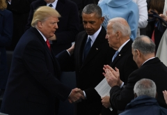 U.S. President Donald Trump shakes hands with former Vice President Joe Biden after being sworn in as president on January 20, 2017 at the U.S. Capitol in Washington, D.C. (Photo credit: MARK RALSTON/AFP via Getty Images)