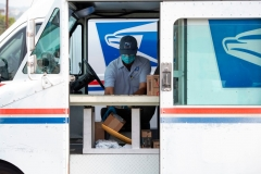 Mail carrier Oscar Osorio continues to deliver mail in Los Feliz amid the Covid 19 pandemic, April 29, 2020, in Los Angeles, California. - Everyday the United States Postal Service (USPS) employees work and deliver essential mail to customers. (Photo by VALERIE MACON/AFP via Getty Images)