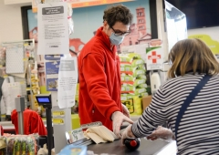 ROME, ITALY - MAY 06: A Cashier at a supermarket works behind a protective perspex barrier while wearing a face mask and gloves as a preventive measure during the Coronavirus (COVID-19) crisis on May 06, 2020 in Rome, Italy. Italy was the first country to impose a nationwide lockdown to stem the transmission of the Coronavirus (Covid-19), and its restaurants, theaters and many other businesses remain closed. (Photo by Silvia Lore/Getty Images)