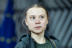 """Greta Thunberg has advocated for """"system change."""" (Photo credit: KENZO TRIBOUILLARD/AFP via Getty Images)"""