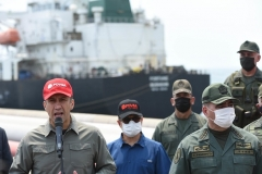 Maduro regime officials, including Industry Minister Tareck El Aissami, left, and Defense Minister Vladimir Padrino, welcome the first Iranian tanker at the El Palito refinery on Monday. (Photo by AFP via Getty Images)
