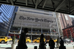 Featured is the front of the New York Times office. (Photo credit: Gary Hershorn/Corbis via Getty Images)