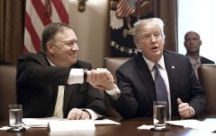 Secretary of State Mike Pompeo and President Trump during a 2018 cabinet meeting at the White House. (Photo by Olivier Douliery/AFP via Getty Images)