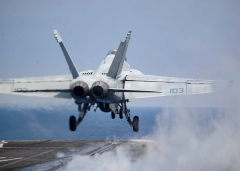 A F/A-18F Super Hornet takes off from the carrier USS Harry S. Truman. (Photo by Smith Collection/Gado/Getty Images)