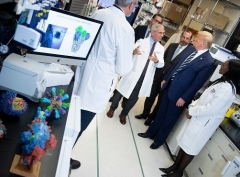 Dr. Anthony Fauci shows President Trump around the NIH's Vaccine Research Center in Bethesda, Md. in March. (Photo by Brendan Smialowski/AFP via Getty Images)