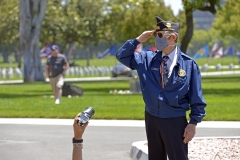 A veteran salutes for a camera at Los Angeles National Cemetery on Memorial Day during the COVID-19 outbreak on May 25, 2020 in Los Angeles, Calif. (Photo credit: Michael Tullberg/Getty Images)