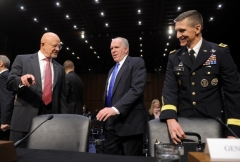 CIA Director John Brennan, Director of National Intelligence James Clapper, and then-Defense Intelligence Agency Director Lt. Gen. Michael Flynn prepare to testify before a Senate hearing on national security threats on March 12, 2013. (Photo by JEWEL SAMAD/AFP via Getty Images)