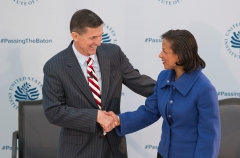 Incoming National Security Adviser Michael Flynn greets President Obama's National Security Advisor Susan Rice at a ceremonial passing of authority, part of the presidential transition, on January 10, 2017. (Photo by CHRIS KLEPONIS/AFP via Getty Images)