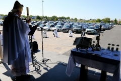 In Chalons-en-Champagne, Bishop Francois Touve leads an open-air Mass on May 17 for some 500 parishioners, sitting in their vehicles. (Photo by Francois Nascimbeni/AFP via Getty Images)