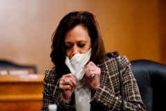 Sen. Kamala Harris, D-CA, removes her face mask at a recent Senate hearing. (Photo by ANDREW HARNIK/POOL/AFP via Getty Images)