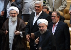 Iran's former intelligence minister Ali Fallahian, left, photographed with then-newly elected President Hassan Rouhani, in 2013. (Photo: IRNA)