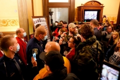 Protesters try to enter the Michigan House of Representative chamber during a protest against the governor's COVID-19 restrictions on April 30, 2020. (Photo by JEFF KOWALSKY/AFP via Getty Images)