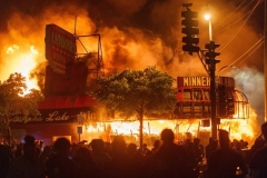 Protesters gather in front of a liquor store in flames near the Third Police Precinct, which they later burned, on May 28, 2020 in Minneapolis, Minnesota, during a protest over the death of George Floyd. (Photo by KEREM YUCEL/AFP via Getty Images)