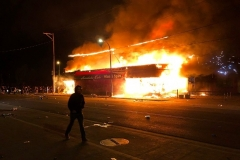 Flames rise from a liquor store near the Third Police Precinct in Minneapolis on Thursday night. (Photo by Kerem Yucel/AFP via Getty Images)