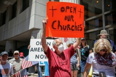 Nationwide, calls are growing to reopen churches. Here, the protest took place in San Diego on May 1. One Virginia church is suing the Commonwealth in federal court. (Photo by SANDY HUFFAKER/AFP via Getty Images)