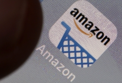 Amazon's app logo is featured on an iPhone screen. (Photo credit: Chesnot/Getty Images)