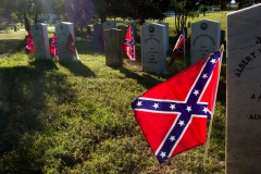 RICHMOND, VA - OCTOBER 18: Confederate flags decorate the graves of Confederate soldiers killed during the Civil War on October 18, 2018 in the historical Hollywood Cemetery in Richmond, Virginia. (Photo by Andrew Lichtenstein/Corbis via Getty Images)