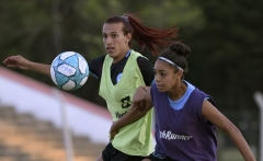 Argentine football player Mara Gomez (L) and teammate Agustina Aguilera vie for the ball during a training session with her first division women's football team, Villa San Carlos, in La Plata, Argentina, on February 14, 2020. - Gomez, a transgender woman, was waiting to get the official authorization from the Argentina Football Association (AFA) to compete in the women's first division football tournament before the new coronavirus outbreak. (Photo by JUAN MABROMATA/AFP via G
