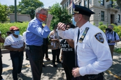 New York Mayor Bill de Blasio greets Inspector Isa Abbassi of the 120th Precinct as New York City's second Black Lives Matter mural is painted by volunteers between Borough Hall and the 120th Precinct in the Borough of Staten Island on June 19, 2020, as the city marks Juneteenth. (Photo by BRYAN R. SMITH/AFP via Getty Images)