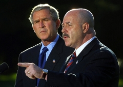 WASHINGTON, UNITED STATES: (FILES) This 03 October, 2003, file photo shows former New York City Police Commissioner Bernard Kerik (R), with US President George W. Bush (L), addressing the media on the South Lawn of the White House in Washington, DC. (Photo by MANNY CENETA/AFP via Getty Images)