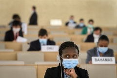 Masked and practicing COVID-19 social distancing, U.N. Human Rights Council delegates consider a resolution Friday after an urgent debate over racism in law enforcement. (Photo by Fabrice Coffrini/POOL/AFP via Getty Images)