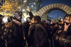Iranian riot police in stand off with protestors outside a Tehran university last January.  (Photo by AFP via Getty Images)