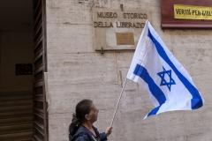 A man waves an Israeli flag. (Photo credit: Stefano Montesi/Corbis/Corbis via Getty Images)