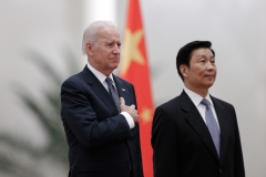 Chinese Vice President Li Yuanchao (R) and U.S. Vice President Joe Biden (L) listen to their national anthems during a welcoming ceremony inside the Great Hall of the People in Beijing on December 4, 2013. (Photo credit: LINTAO ZHANG/AFP via Getty Images)