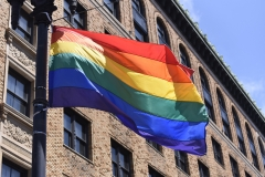 The LGBT flag flies next to a building. (Photo credit: Meera Fox/Getty Images)