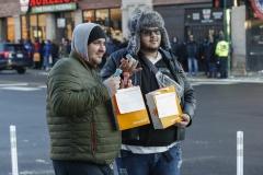 Individuals purchase marijuana following its legalization. (Photo credit: KAMIL KRZACZYNSKI/AFP via Getty Images)