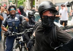 Antifa radicals wore black masks long before the COVID-19 pandemic. This radical was photographed in Washington, D.C., in July 2019. (Photo by ANDREW CABALLERO-REYNOLDS/AFP via Getty Images)