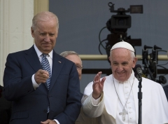 Pope Francis joins then-Vice President Joe Biden on a balcony after speaking at the US Capitol on September 24, 2015. (Photo by Andrew Caballero-Reynolds/AFP via Getty Images)