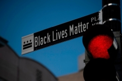"A new street sign reading ""Black Lives Matter Plaza NW"" has gone up at the intersection of H and 16th Streets near the White House in Washington, D.C., along with an enormous ""Black Lives Matter"" street painting. (Photo by ROBERTO SCHMIDT/AFP via Getty Images)"