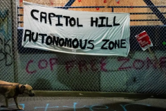 """Capitol Hill Autonomous Zone"" sign hangs on the exterior of the Seattle Police Departments East Precinct on June 9, 2020 in Seattle, Washington. (Photo by David Ryder/Getty Images)"