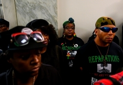 Activists wait to enter a hearing about reparations for the descendants of slaves before a House Judiciary Subcommittee on June 19, 2019. (Photo by ANDREW CABALLERO-REYNOLDS/AFP via Getty Images)