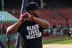 Xander Bogaerts #2 of the Boston Red Sox wears a Black Lives Matter shirt during batting practice before the Opening Day game against the Baltimore Orioles on July 24, 2020. (Photo credit: Billie Weiss/Boston Red Sox/Getty Images)
