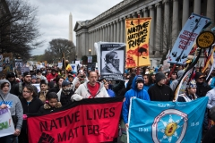 Activists gather protesting the Dakota Pipeline during the Native Nations Rise protest on March 10, 2017 in Washington, D.C. (Photo credit: BRENDAN SMIALOWSKI/AFP via Getty Images)