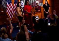 """US Representatives Ayanna Pressley (D-MA), Ilhan Omar (D-MN)(2R), Rashida Tlaib (D-MI) (L), and Alexandria Ocasio-Cortez (D-NY) (R) hold a press conference, to address remarks made by US President Donald Trump earlier in the day, at the US Capitol in Washington, DC on July 15, 2019. - President Donald Trump stepped up his attacks on four progressive Democratic congresswomen, saying if they're not happy in the United States """"they can leave."""" (Photo by BRENDAN SMIALOWSKI/AFP via Getty Images)"""