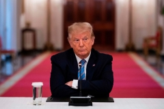 President Donald Trump sits with his arms crossed during a roundtable discussion on the Safe Reopening of Americas Schools during the coronavirus pandemic, in the East Room of the White House on July 7, 2020, in Washington, DC. (Photo by JIM WATSON/AFP via Getty Images)