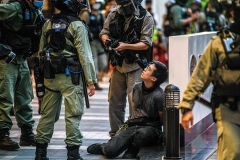 Hong Kong police arrest a protester during a rally against the new Beijing-imposed national security law on July 1, the 23rd anniversary of the city's handover from Britain to China. (Photo by Anthony Wallace/AFP via Getty Images)