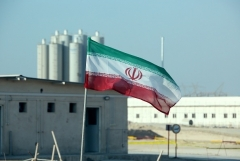 Iran's national flag flies at a nuclear power plant. (Photo by Atta Kenare/AFP via Getty Images)