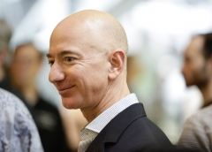 Chief Executive Officer of Amazon, Jeff Bezos, tours the facility at the grand opening of the Amazon Spheres, in Seattle, Washington on January 29, 2018. (Photo credit: JASON REDMOND/AFP via Getty Images)
