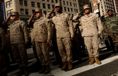 Members of the U.S. Marines salute during the opening ceremonies of the 87th Veterans Day Parade in New York City. (Photo credit: Ramin Talaie/Corbis via Getty Images)