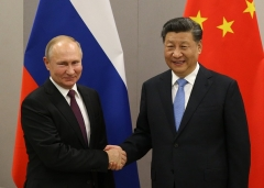 Russian President Vladimir Putin with Chinese President Xi Jinping in Nov. 2019. (Photo by Mikhail Svetlov/Getty Images)