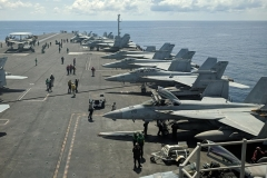 U.S. Navy F/A-18 Super Hornet fighters onboard the aircraft carrier USS Ronald Reagan in the South China Sea. (Photo by Catherine Lai/AFP via Getty Images)