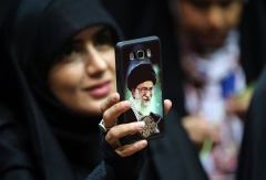 An image of supreme leader Ayatollah Ali Khamenei on an Iranian woman's phone. (Photo by -/AFP via Getty Images)